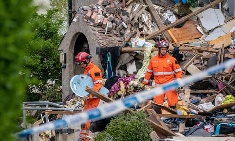 Emergency workers at the scene of the suspected gas explosion in Heysham, Lancashire.