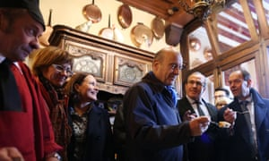 Alain Juppé tries an omelette during a visit to Mont Saint-Michel in October 2015