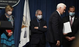 US Vice President Mike Pence, second from right, walks off of the stage following the conclusion of a briefing with the Coronavirus Task Force at the Department of Health and Human Services in Washington on 26 June, 2020.