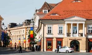 Police patrol the main square in Sibiu before a European summit
