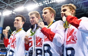 From left: James Guy, Duncan Scott, Dan Wallace and Stephen Milne pose with their medals.