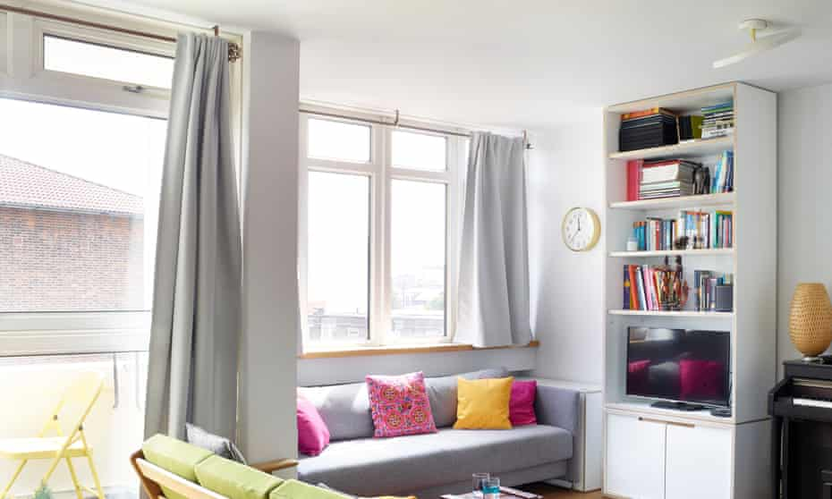 The living area, with grey sofa and multi-coloured cushions