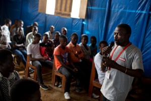 Richard Ndolya health worker with Medair talks to the community