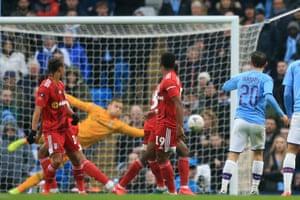 Silva shoots to score City's second goal.