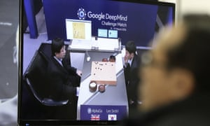 A man watches a TV screen showing Lee Sedol taking on a Google AI program in Seoul, South Korea on 9 March 2016