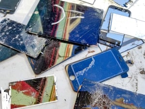 Broken CellphonesClose-up of a large number of broken cellphones, including cracked cellphone screens with exposed wiring, on a white surface, suggesting E Waste recycling, hacking or cybersecurity, December 7, 2018. (Photo by Smith Collection/Gado/Getty Images)