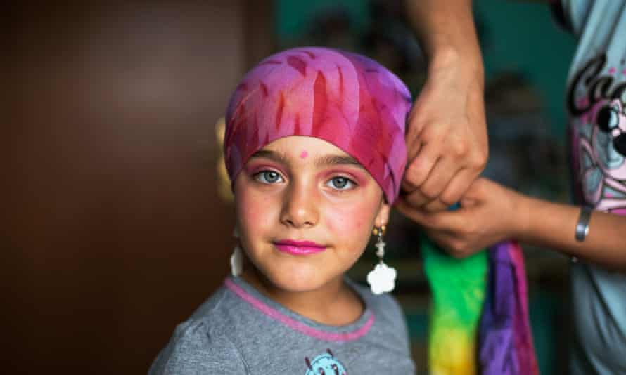 Zayneb, seven, plays dress-up with her mother, Sivan
