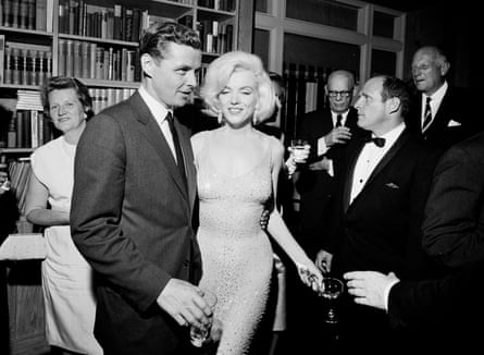 Marilyn Monroe still wearing the dress, with Steve Smith, Kennedy's brother-in-law, at a reception at Madison Square Garden.