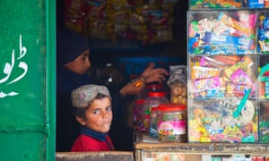 Boys are seen in a sweet shop in Punjab province, Pakistan