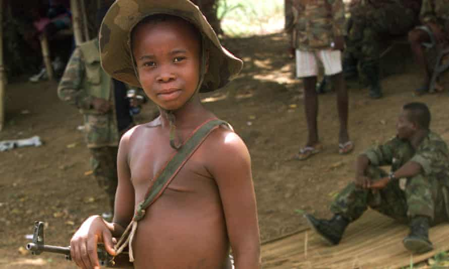 A child soldier at a Sierra Leone army checkpoint in 2000