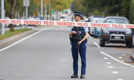 Police officers cordon off the area around the two mosques attacked in Christchurch