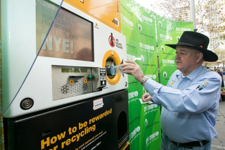 Ian Kiernan of Clean Up Australia deposits a plastic bottle into the Envirobank, a reverse vending recycling machine, in Sydney.