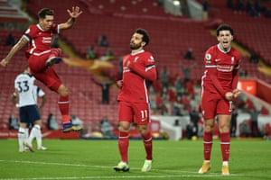 Salah celebrates with Jones and Firmino.