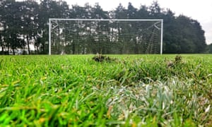 A former football coach from one of England's professional clubs has been charged with a string of alleged sexual offences.