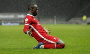 Sadio Mane slides in celebration.