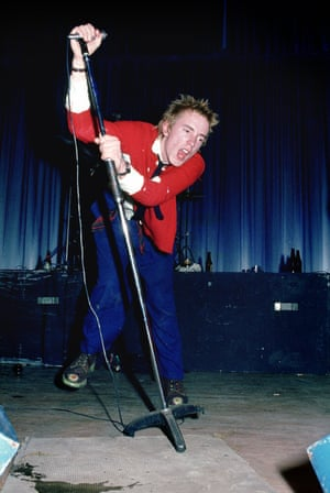 Johnny Rotten performing live onstage with the Sex Pistols at Dunstable's Queensway Hall