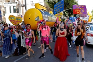 Israelis wearing costumes take part in a parade during the festivities of the Jewish Purim holiday on 26 February, 2021 in Tel Aviv. Israel imposed a night-time curfew for three nights from yesterday evening to curb the spread of coronavirus from 8:30 pm to 5:00 am.