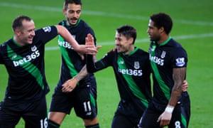 Stoke City's Bojan Krkic celebrates with Charlie Adam, Mato Joselu and Glen Johnson after scoring from the spot.
