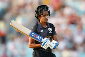 Manchester Originals' Harmanpreet Kaur looks dejected as she walks off after losing her wicket for 29.