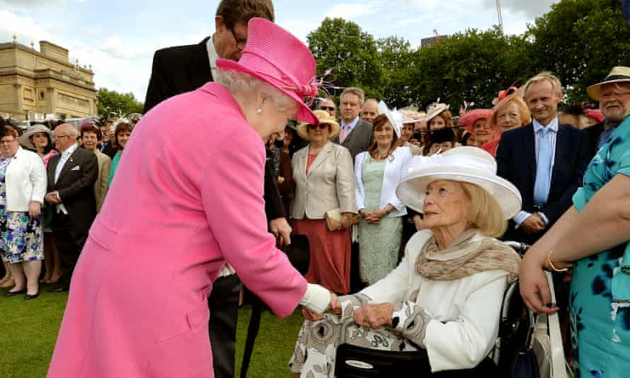 Gena Turgel is greeted by the Queen at a Buckingham Palace garden party in May 2015.