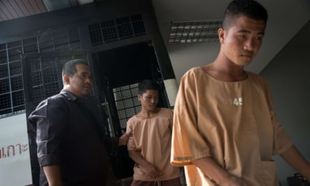 Zaw Lin (R) arrives in a prison transport van outside Koh Samui courthouse as fellow Myanmar national Win Zaw Tun follows. Both men are on trial for the murder of British tourists Hannah Witheridge and David Miller.