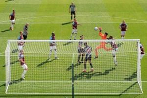 West Ham's goalkeeper Lukasz Fabianski fails to catch a ball as he gifts a goal to Newcastle's Joelinton.