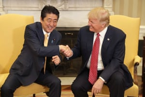 U.S. President Donald Trump (R) and Japanese Prime Minister Shinzo Abe shake hands before bilateral meetings in the Oval Office at the White House February 10, 2017 in Washington, DC
