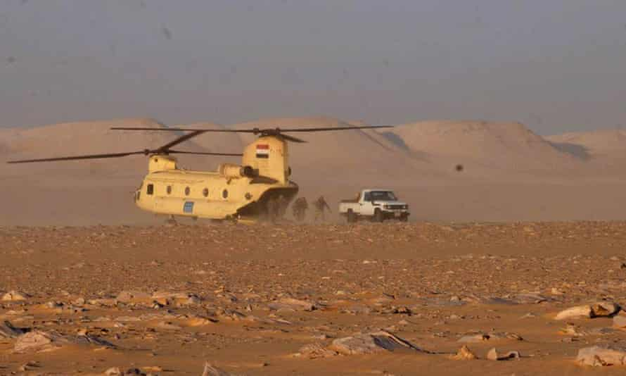 Soldiers leave a helicopter during an operation near the Bahariyah oasis