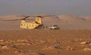 Soldiers leave a helicopter during an operation near the Bahriyah Oasis in the Western Desert of Egypt, an area where Egyptian forces mistakenly attacked a group of Mexican tourists, killing 12 people.