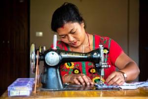 Sangita sews a sanitary pad