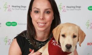 Beth Tweddle with Kody, a hearing dog puppy