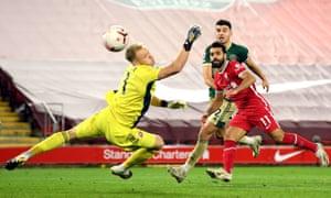 Liverpool's Mohamed Salah smacks the ball into the net.