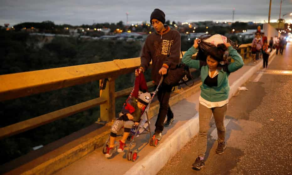 Migrants from Honduras head north through Guatemala in January 2019. The difficulty and danger of the journey to the US is a factor in a rise in Latin American migrants heading for Europe.