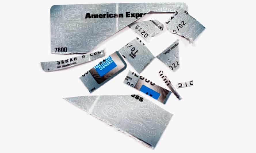 An American Express credit card cut up into pieces.
