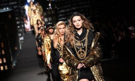 Gigi Hadid walks the catwalk during the Moschino x H&M launch.