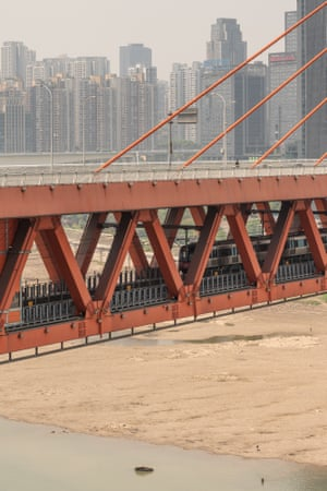 The orange bridge crosses straight through the densest part of the city and serves as its main artery. Multiple layers of transportation are stacked on top of each other