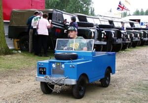 A boy drives a scale model Land Rover during the annual Land Rover Owners get-together at Billing Aquadrome, Northampton, marking 50 years of the Land Rover in 1998