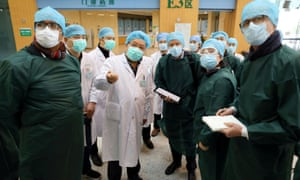 Experts from China and the World Health Organization (WHO) joint team wearing face masks visit the Wuhan Tongji Hospital in Wuhan, the epicentre of the novel coronavirus outbreak, in Hubei province.