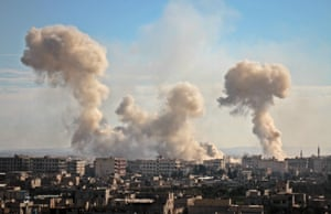 Smoke rises from buildings following bombardment in eastern Ghouta