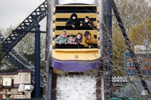Members of the public ride on the Tidal Wave water slide ride at Thorpe Park theme park in Chertsey, southwest of London.