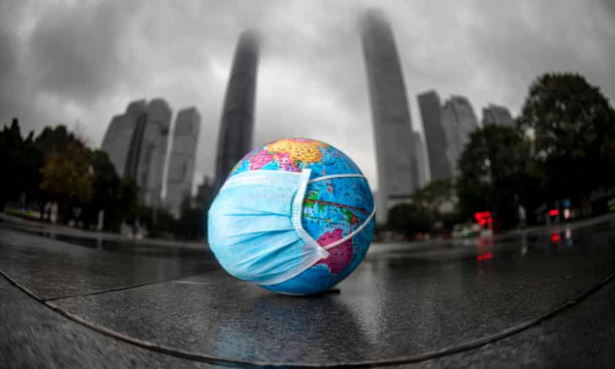 The world in a face mask, in Guangzhou, Guangdong province, China, marking Earth Day 2020, on 22 April.