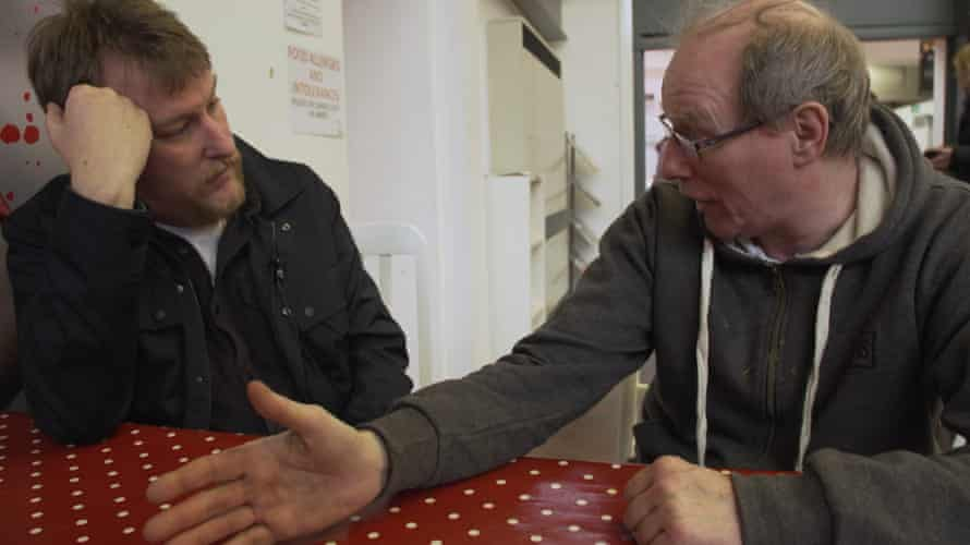John Harris, left, talks to Charlie Dale in Wigan in 2019.