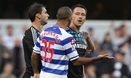 Chelsea captain John Terry (right) speaking to QPR's Anton Ferdinand during the Barclays Premier League match at Loftus Road, London.