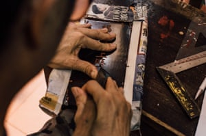 A worker crafts words on an ancestral tablet at an ancestral tablet shop