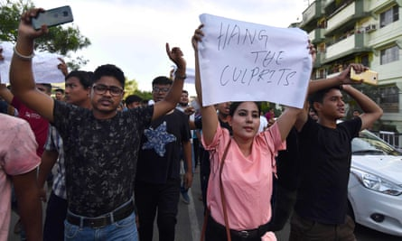 Protesters in Assam, India, demand action over the deaths of two men whose murder in June 2018 was linked to false rumours spread on WhatsApp.