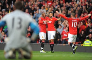 Ashley Young, Ryan Giggs and Wayne Rooney enjoy Manchester United's 8-2 win over Arsenal in 2011.