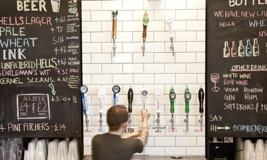 Pints are pulled at Camden Town Brewery bar in north London