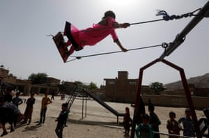 An Afghan child plays on a swing
