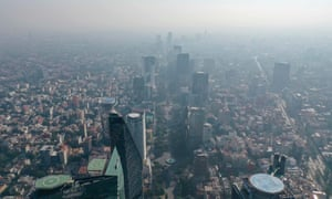 An aerial view showing low visibility due to air pollution in Mexico City on 30 March