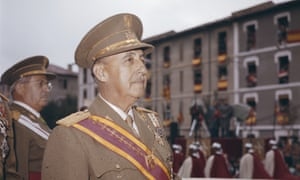 General Francisco Franco watches a parade march past in Spain in 1969.